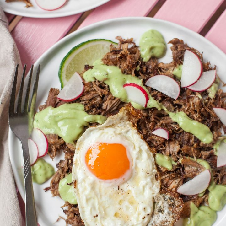 Carnitas con huevo with avocado crema