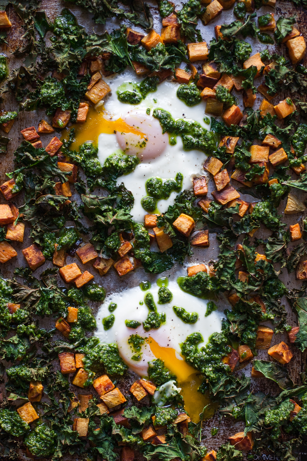 Sheet Pan Baked Eggs with Sweet Potatoes, Kale, & Cilantro-Pepita Pesto (Paleo, Whole30)